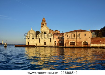 View from the Venice lagoon of the church of San Michele in Isola on the cemetery island of San Michele at sunset, Venice, Italy  - stock photo