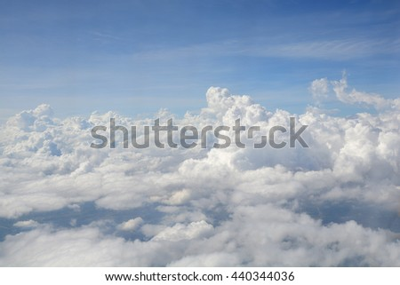 View from the window of an airplane flying in the clouds - stock photo