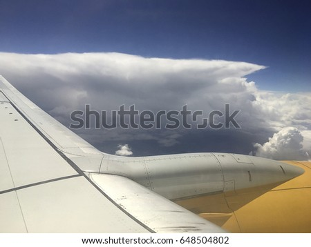 View from the window of the plane to the clouds