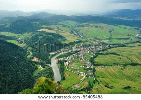 view from Three Crows hilltops, village Cerveny Klastor (Slovakia) and Sromowce Nizne (Poland) divided by river Dunajec - stock photo