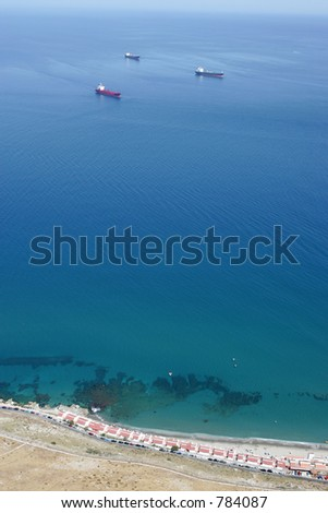 View from tip of Rock of Gibraltar looking out to sea and the Spanish coast beyond - stock photo