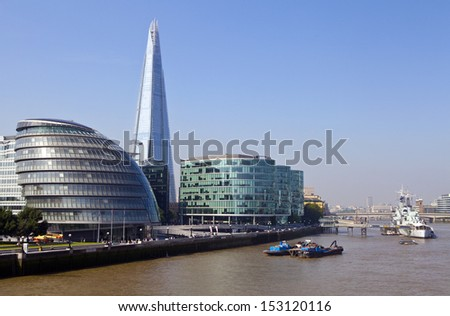 View from Tower Bridge taking in the sights of The Shard, City Hall, HMS Belfast and the River Thames in London. - stock photo