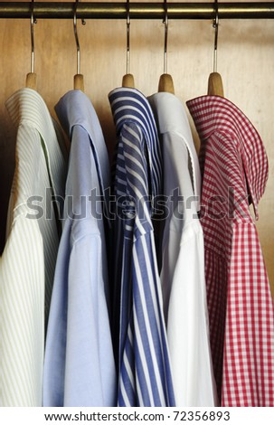 view in profile of shirts hanging - stock photo