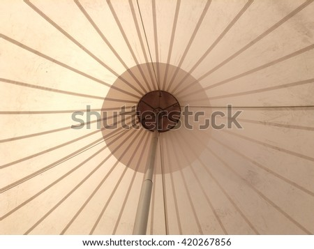 View inside and outside on the top of giant white entertainment tent angle view - stock photo