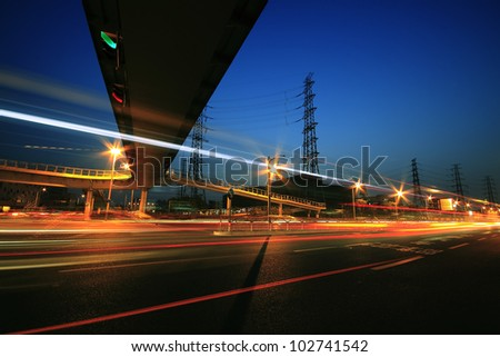 View long exposure photographs of urban night dusk Highway traffic and transmission tower in Shanghai - stock photo