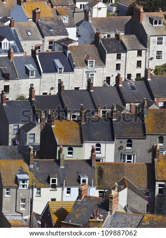 View looking down on tightly packed terraces of houses - stock photo