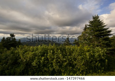 View looking out towards the Green Mountains in Vermont from the Summit of Mount Greylock In Western Massachusetts. - stock photo