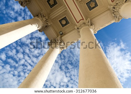 view looking up at columns of historic building - stock photo