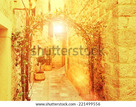 View narrow street in old district - stock photo