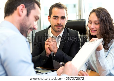 VIew of a Attractive boss doing interview with his assistant