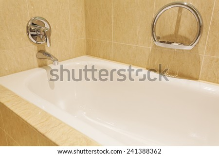 View of a bathtub in a luxurious hotel room - stock photo