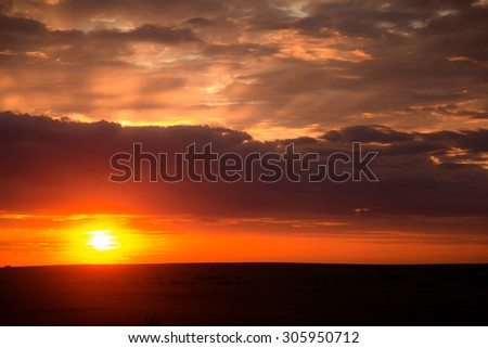 View of a beautiful cloudy sky with sun rays - stock photo