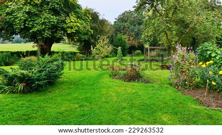 View of a Beautiful Domestic Garden in Summer  - stock photo