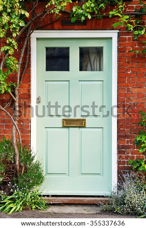 View of a Beautiful Front Door of a Red Brick House - stock photo