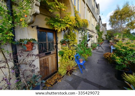 View of a Beautiful Pathway past Old Cottages - stock photo