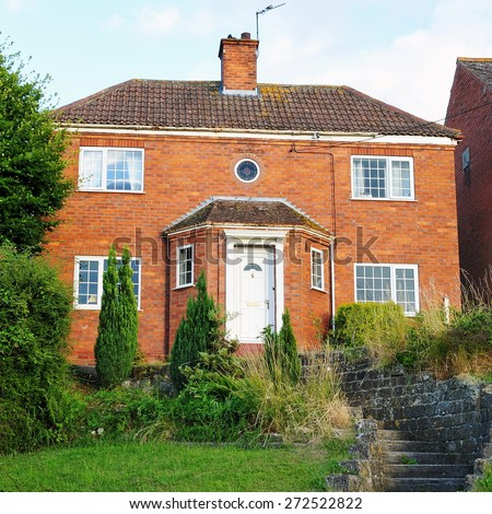 View of a Beautiful 1930s Era Red Brick House on a London Street - stock photo