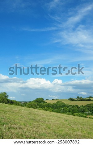 View of a Beautiful Summer Sky with Green Fields Below - English Countryside in the Avon Valley in Wiltshire - stock photo