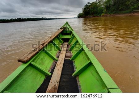 View of a boat bow in the Madre de Dios River, Puerto Maldonado, Peru. - stock photo