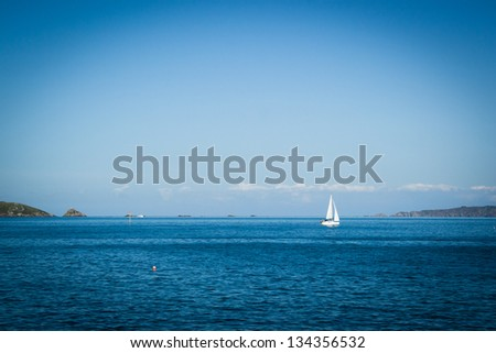 View of a boat off the coast of Guernsey