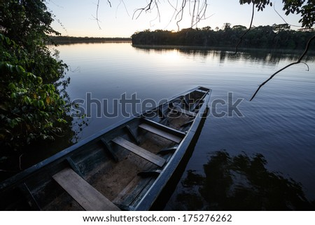 View of a boat parked on the river bank, in Tambopata national park of Per�º. - stock photo