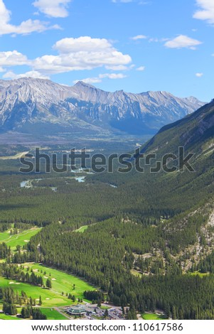 View of a Bow river valley and golf courses against Rocky Mountains. Banff National Park. Alberta. Canada - stock photo