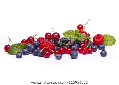 View of a bunch of tasty blueberries, red currant and raspberries isolated on a white background. - stock photo