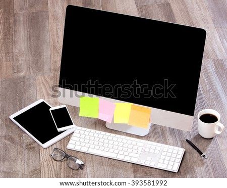 View of a Businessman's desk in high definition with laptop, tablet and mobile