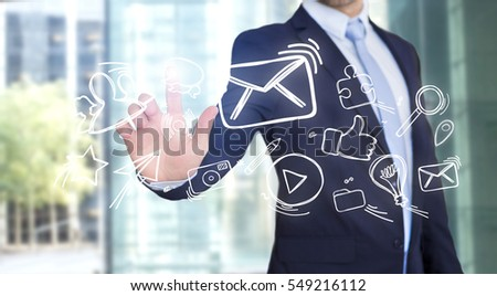 View of a Businessman touching technology interface with Internet icons