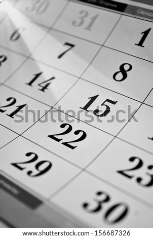 View of a calendar with dates for each day of the month and focus to the 15th - stock photo