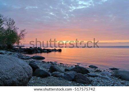 View of a Canoe and pink sunset, Hecla Island, Provincial Park