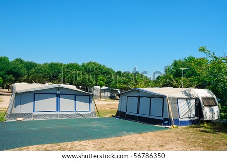 view of a caravan park on the beach in the summer - stock photo