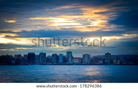 View of a city beach in the sunset.