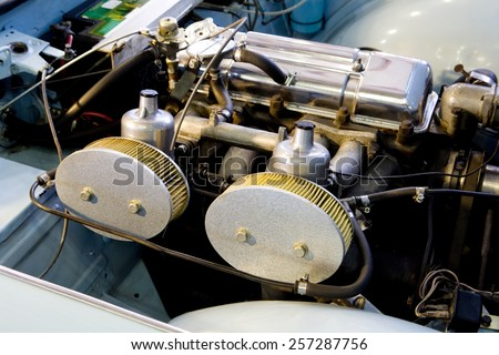 View of a classic car engine with twin carburetor.  Classic car engine.