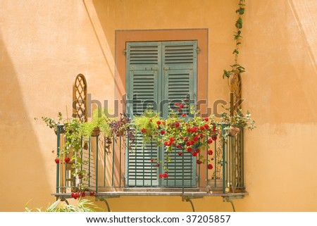 view of a colourful balcony in italy - stock photo