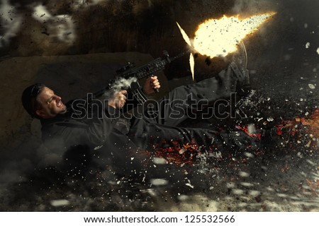 View of a contracted type killer agent thrown in middle air from an explosion firing a machine gun. - stock photo