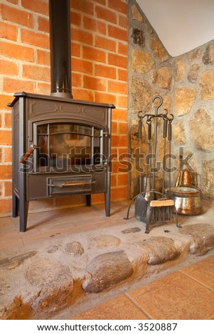 View of a cozy old fireplace in the living room - stock photo