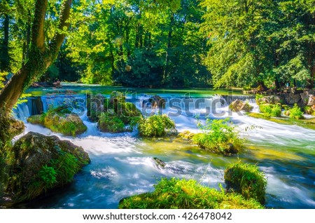 view of a creek in the English garden in Munich, Bayern, Germany - stock photo