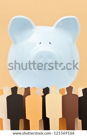 View of a crowd in front of a piggy bank. Concept of people against banks. Concept of people looking after their savings. - stock photo