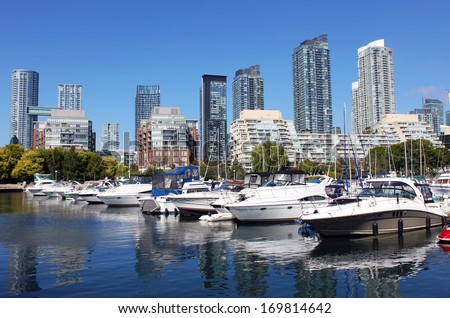 View of a downtown Toronto marina and residential buildings - stock photo