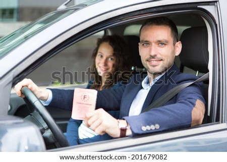 View of a Driver in his car after getting his driving licence