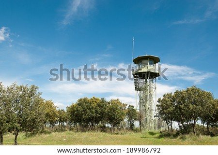 view of a fire lookout tower in Madrid, Spain - stock photo