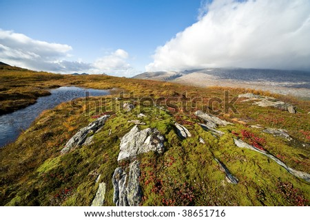 View of a fjord landscape in the north of Norway along the national heritage road kystriksvejen - stock photo