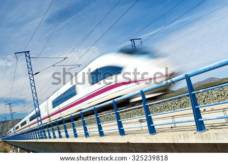 view of a high-speed train crossing a viaduct in Arandiga, Zaragoza, Aragon, Spain. AVE Madrid Barcelona.