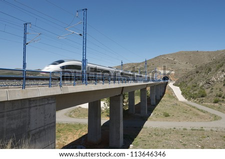 view of a high-speed train crossing a viaduct in Bubierca, Saragossa, Aragon, Spain; AVE Madrid Barcelona - stock photo