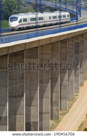 view of a high-speed train crossing a viaduct in Calatayud, Saragossa, Aragon, Spain, AVE Madrid Barcelona. - stock photo
