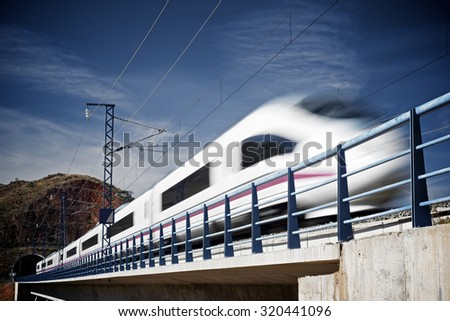 view of a high-speed train crossing a viaduct in Purroy, Zaragoza, Aragon, Spain. AVE Madrid Barcelona. - stock photo
