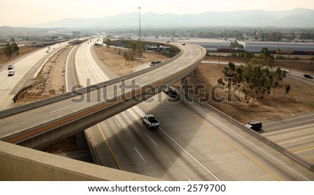 View of a Highway Interchange in Southern California on Smoggy Day - stock photo