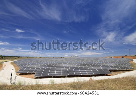 view of a huge solar field for renewable electric energy production - stock photo