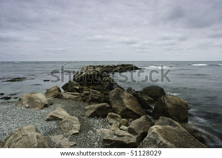 View of a jetty from the shoreline along The Ocean Drive in Newport,RI