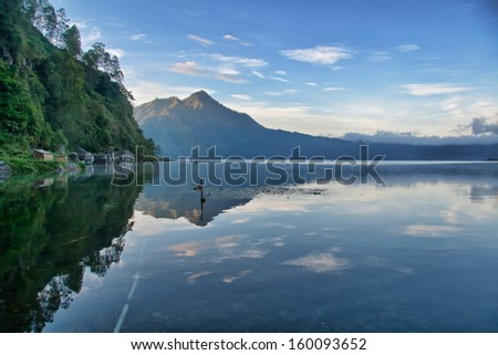 View of a Lake in Bali Indonesia taken after sunrise - stock photo